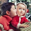 Little boys holding gifts near Christmas tree, Little boy weari — Stock Photo #58807323