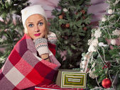 Beautiful girl holding gifts. Christmas — Stock Photo
