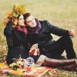 Great relationship. Young sweet couple having date in autumn park. — Stock Photo #54170459