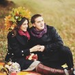 Great relationship. Young sweet couple having date in autumn park. — Stock Photo #54170487