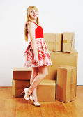 Young blond woman resting from moving into a new home. — Stock Photo
