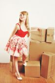 Young blond woman resting from moving into a new home. — ストック写真
