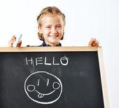 Smiling cute school girl drawing. — Stock Photo