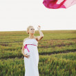 Portrat of young pregnant woman in a white greek dress — Stock Photo #57134673