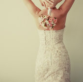 Beautiful young bride with bouquet. — Stock Photo
