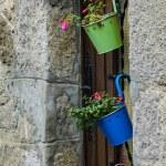 Wooden house door decorated with  metal pots — Stock Photo #56092967