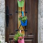 Wooden house door decorated with metal pots — Stock Photo #56092999