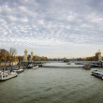 Alexander III Bridge and tourist cruise ships — Stock Photo #60993383