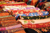 Colorful shawls at street bazaar. — Stock Photo