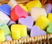 Heart shaped soaps in wicker basket. — Stock Photo