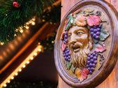 Bacchus (Dionysus) mask at Christmas market — Stock Photo