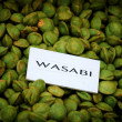 Wasabi peas in wicker basket for sale — Stock Photo #61002089