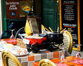 Fondue Savoyarde and Raclette displayed in restaurant. — Stock Photo