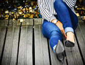 Woman sitting on Love locks bridge — Stock Photo