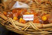 Dried sugared kumquat in wicker basket — Stock Photo