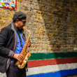 Saxophone player at Brick Lane market — Stock Photo #74012581