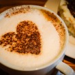Cup of coffee with heart shape on milk foam — Stock Photo #74013927