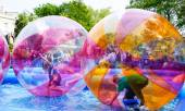 Kids zorb inside large balls during Canalway Cavalcade — Stock Photo