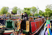 Woman participates in Canalway Cavalcade of traditional boats — Stock Photo