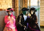 Three masks during the traditional Carnival. — Stock Photo