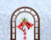 Christmas bells with bow on shiny background snowflakes — Stockfoto