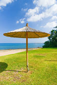Parasol of straw on the sea — Stock Photo