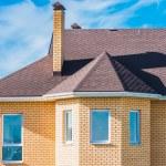 Постер, плакат: House with a gable roof window