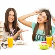 Two teenage girls studying for school together having fun — Foto de Stock   #52256705