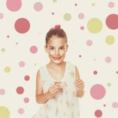 Cute messy little girl eating cocoa cream — Stock Photo