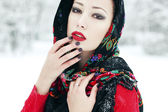 Winter fashion concept. Portrait of young woman in red cardigan  — Stock Photo