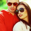 Eyewear concept. Smiling young woman and her boyfriend in trendy — Stock Photo
