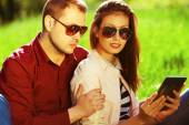 Gadget users concept. Romantic couple in trendy casual clothing  — Stock Photo
