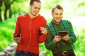 Gadget user concept. Funny hipster guys in trendy casual clothin — Stock Photo