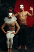 Hocus pocus concept. Two mime artists, clowns with white masks o — Foto Stock