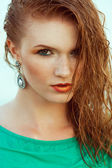 Fashion portrait of young model with wet long ginger (red) hair  — Stock Photo