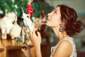 Christmas shopping concept. Emotive portrait of happy beautiful  — Stock Photo