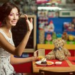 Welcome concept. Portrait of doll like brunette girl with retro — Stock Photo #61432723