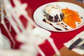 Haute cuisine concept. Ice cream brownie sundae with chocolate s — Stock Photo