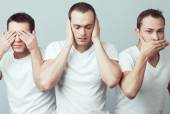 Closeup portrait of three young men in white t-shirts imitating  — Stock Photo