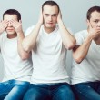 ������, ������: Closeup portrait of three young men in white t shirts imitating