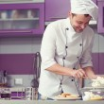 Tiramisu cooking concept. Portrait of smiling man in cook unifor — Stock Photo #64248175
