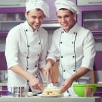 Tiramisu cooking concept. Portrait of two smiling men in cook un — Stock Photo #64544139