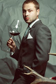 Red wine lover concept. Emotive portrait of handsome stylish man — Stock Photo