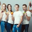 Raw, living food, veggie concept. Group portrait of healthy boys and girls — Stock Photo #77376544