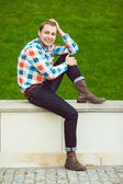 Portrait of happy young happy man relaxing near green lawn — Stock Photo