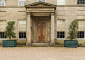 An early nineteenth century neo-classical mansion doorway and co — Stock Photo