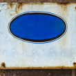 Textured blue rusty metal background, with crude painted oval s — Stock Photo #56309075