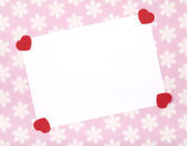 Blank celebrations card with red felt shaped hearts. — Stock Photo
