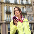 Sporty urban woman texting message on smartphone in street — Stock Photo #59002185