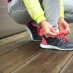 Female runner lacing running sport footwear — Stock Photo #59003059